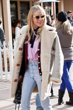 Chloe Sevigny wears '90s-inspired shearling coat, cardigan, jeans and cat-eye sunglasses