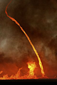 A fire whirl, known to some as the fire tornado. One of the most terrifying sights...