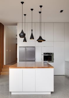 Castlecrag Residence by CplusC Architect's Minimalist Modern Wooden Bar Table and Black Chandelier from Sydney Inspiring Contemporary Timber...