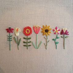From left to right coneflower calla lily zinnia tulip black eyed susan columbine and lily Embroidery Flowers Pattern, Simple Embroidery, Hand Embroidery Stitches, Embroidery Hoop Art, Hand Embroidery Designs, Ribbon Embroidery, Embroidered Flowers, Cross Stitch Embroidery, Embroidery Ideas