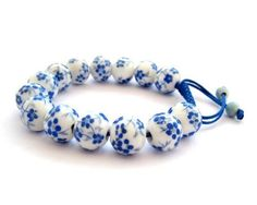Hand Crafted Vintage Style Porcelain Flower Bird Beads Adjustable Bracelet Ovalbuy. $4.99. Free Jewelry Pouch. Material: Porcelain. Adjustable and fit all size of wrist. flower bird. Beads Size: about 12mm