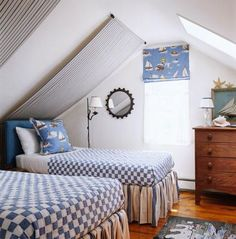 "In one of the small upstairs guest rooms, denim ""canopies"" are hung on rods and draped as closely as possible to the slanted wall."