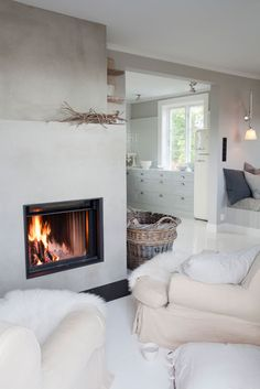 love the cozy fireplace in this beautiful white home