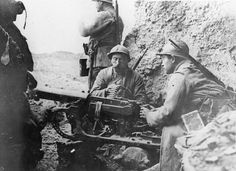 French troops use a captured machine-gun in Fort Douaumont to fire on retreating enemies.