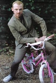 Don't mess with this guy! He means business...on his pink girls bike. lol