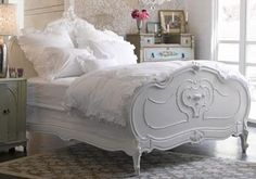 I'd have to sleep well in such a pretty bed.