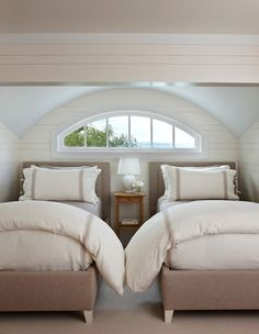 Puff the duvets European-style. This is easy, and any inexpensive duvet and cover from Ikea, Bed Bath & Beyond or HomeGoods will do.