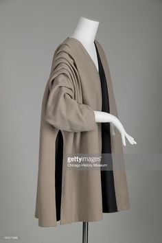 Evening coat, 1950 (side oblique view). Wool gabardine, silk taffeta by Cristobal Balenciaga.