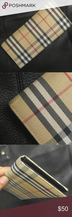 Burberry Wallet Look Alike In great condition other than a few stains that can easily be washed out.  Please note that this says Burberry nowhere on or in it so I'm 99% sure it is not real. Still very cute and no one is going to grab your wallet and look for a tag lol  Again, just a look alike (: Accessories