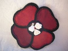 Handmade black felt and crimson satin brooch, with ribbon flowers and beads in the centre. The brooch measures approximately in diameter and has a silver coloured safety clasp would be a lovely accessory to an evening dress. Felt Flowers, Fabric Flowers, Fabric Flower Brooch, Black Felt, Satin, Beads, Handmade, Accessories, Color