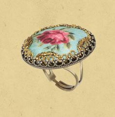 Handmade 60s inspired Michal Negrin Roses ring. The ring is made from printed on fabric combined with fringes. The ring is adjustable