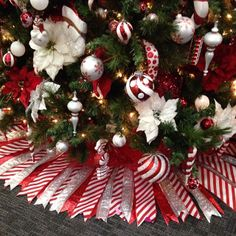 Ribbon Christmas Tree Skirt.  Cut paper pattern & attach cut ribbon with double-sided tape