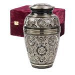 Elegante Eternal Ring Blackgold Urn.This beautiful  hand crafted 10.5 inch brass urn has a stunning blackgold design and a 202 cubic inch capacity with a protective felt bottom. Matching 3 inch keepsake for a token amount of ashes,also available.