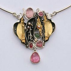 Oooooh! Eve  Llyndorah: Garden Party, Neckpiece in sterling silver and 18k yellow gold on sterling silver neckwire with tourmaline  cabochons and fresh water pearls. 8cm x 6cm x 1cm pendant. Stones by Ray Lipovsky.