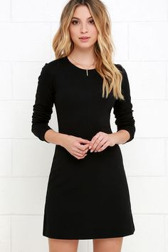 The best dress in your closet this season will definitely be the Perfectly Posh Black Long Sleeve Dress! This medium-weight knit dress will pair with all of your favorite shoes and accessories, with its classic rounded neckline and long, fitted sleeves. Darting adds shape to the bodice atop a darling A-line silhouette. Hidden back zipper.