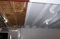 Industrial Look Basement Ceiling Painting - Instead of drywall or drop ceiling, paint it all with an Airless Sprayer in white to make it uniform but blend in and bright. 20 Cool Basement Ceiling Ideas, http://hative.com/cool-basement-ceiling-ideas/,
