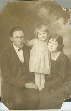 "William ""Earl"" and Lena Wert Baugh with daughter LaDena"