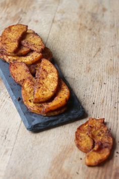 Oven baked Butternut Squash Wedges covered with delicious spices. A delicious and healthy snack or side! Vegan + GF