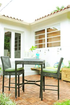 That's the Hampton Bay Fenton 3-Piece Patio High Bar/Bistro Set on the patio of blogger Gloribell Lebron. See more the patio of her Miami home on The Home Depot Blog. || @Gloribell