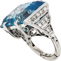 Art Deco Aquamarine, Diamond, Platinum, White Gold Ring  The ring features an emerald-cut aquamarine measuring 16.00 x 13.60 mm and weighing approximately 15.80 carats, enhanced by single-cut diamonds weighing a total of approximately 0.50 carat, set in platinum having a 14k white gold shank