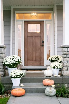 Fall inspired front porch with muted orange and white pumpkins and white potted . - Fall inspired front porch with muted orange and white pumpkins and white potted mums leading up to - Craftsman Front Doors, Wood Front Doors, Craftsman Door Exterior, Steps To Front Door, White Front Doors, Cottage Style Front Doors, Inside Front Doors, Fromt Doors, Front Door With Screen