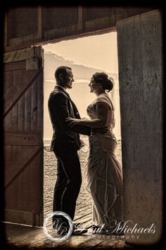Bride and groom at the Pencarrow wool shed. Wellington weddings by PaulMichaels photography http://www.paulmichaels.co.nz/bede-dawn-wedding/