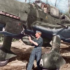 """the_ww2_memoirs A German Luftwaffe crewman hand cranks a Junkers Ju-87 """"Stuka"""" dive-bomber belonging to I./Schlactgeschwader 3-I./SG3 stationed in Immola, Finland, June, 1944. Finland houses many Luftwaffe airfields because it was in perfect range of Russ"""