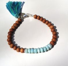Dominican Larimar and Sandalwood Beaded Tassel Bracelet, Hill Tribe Silver Charm, Caribbean Blue Larimar Beaded Stacking Bracelet