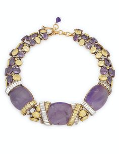 AN AMETHYST, CITRINE AND RHINESTONE NECKLACE, BY IRADJ MOINI Designed as three large cabochon amethysts set between rhinestone 'X' elements to the necklace of oval citrines, amethysts and rhinestones. The Private Collection of Joan Rivers