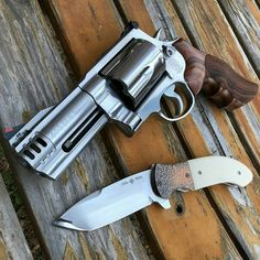 """Caliber """"500 Smith & Wesson"""" in their """"X frame"""" with pretty wooden grips."""