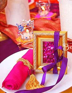 small party table decorations and rolled like percian carpet napkins decorated with ribbons and golden tassels for party table decorating ideas in moroccan style