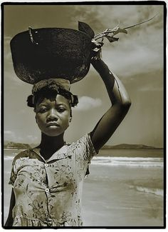 Haitian girl carrying a bucket on her head. I don't know what it is about this picture. It's just so powerful.