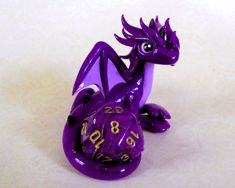 Kawaii dragons and beasties to keep your dice safe