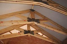 Construction dimensional lumber built up into scissors trusses.