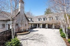 This home is like an old English inn or French country home transported into inner Toronto. It would be quaint if it wasn't a mansion. English Inn, Toronto Houses, New Condo, Exposed Wood, French Country House, Wood Beams, Hotel Spa, House Prices, Home Theater