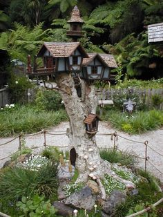 Awesome set of birdhouses built on a tall tree stump by eluthrea