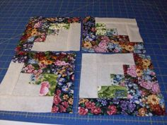 Floral fabric Strip pieced log cabin blocks I like the layout of this. If have to play to see how it would work for a whole quilt