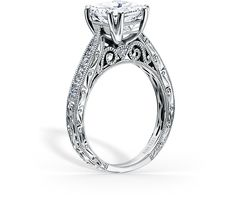 Award winning design. This timeless classic is a tapered engagement ring from the Stella and most prized creations collection. It features 0.21 ctw of diamonds. The signature handcrafted details include wheat hand engravings, signature filigree, peek-a-boo diamonds and milgrain edging. The center 1 carat princess stone (shown) is a customized option.