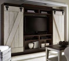 Today's interior style is highlighted in an entertainment wall unit. The Lancaster Entertainment Wall by Liberty Furniture features sliding barn style doors with planked accents. The two tone antique white and brown create a casual appeal. Living Furniture, Living Room Decor, Bedroom Furniture, Furniture Ideas, Bedroom Decor, Furniture Removal, Kitchen Furniture, Store Concept, Entertainment Wall Units