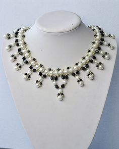 Black and White Pearl Necklace with Glass Beads                                                                                                                                                                                 More