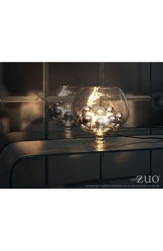The elegance of chrome orbs enhances the look of this unique table lamp. The Terran lamp has one bulb that shines and reflects off of the chrome spheres. The lamp is UL approved.