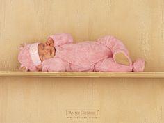 baby sleeping on shelf