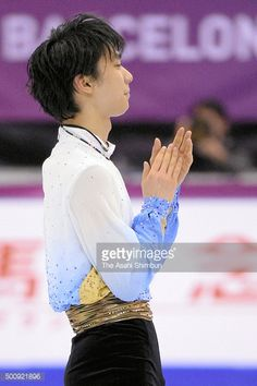 Yuzuru Hanyu of Japan applauds fans after competing in the Men's Short Program during day one of the ISU Grand Prix of Figure Skating Final 2015/2016...
