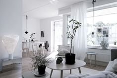 The harmonic monochrome color palette and the Scandinavian decor style gives…
