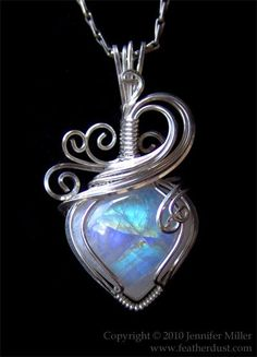 Glowing CrystalHeart Moonstone hand wrapped in Argentium sterling silver  |  Artist: © 2010 jennifer Miller aka Nambroth on deviantART