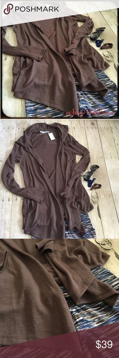 🆕 Maurices Chocolate brown hooded flyaway jacket 🆕 Maurices Chocolate brown hooded flyaway jacket! This is absolutely perfect for this time of year! It is a beautiful light weight chocolate brown flyaway jacket! Toss it over just about anything to make an adorable outfit! Goes perfect over LulaRoe leggings! 66% polyester 31% rayon 3% spandex! SO SO CUTE! Maurices Sweaters Cardigans
