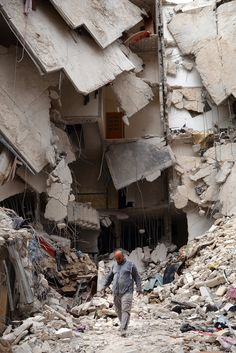 A man walks amid destruction in Aleppo, Syria. A top U. official said the United States is mulling ways to step up support for the Syrian opposition. Syrian Civil War, Refugee Crisis, Syrian Refugees, Aleppo, Mail Art, Palestine, Destruction, Abandoned Places, Civilization
