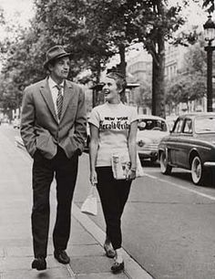 Love them walking... but, he should be carrying her stuff.