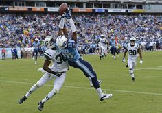 Tennessee Titans wide receiver Justin Hunter (15) catches a 16-yard touchdown pass as he is defended by New York Jets cornerback Darrin Walls (30) in the second quarter of an NFL football game on Sunday, Sept. 29, 2013, in Nashville, Tenn. (AP Photo/Mark Zaleski)