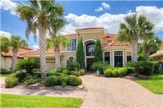 1314 Westshore Dr Houston, TX 77094 Stunning Mediterranean style property w/ lake views in Windsor Park Lakes. Home features beautiful stucco exterior w/ tile roof, custom paver drive and porte cochere. Completely upgraded w/ intricately designed tile floors, crisp white plantation shutters, and a dramatic wrought iron stair rail. Cook s kitchen includes flawless granite counters, double oven, and a large center island. Spacious screened patio leads to a resort style pool and spa! Stucco Exterior, Stucco Walls, Mediterranean Architecture, Mediterranean Style, Wrought Iron Stair Railing, Windsor Park, Screened In Patio, Lush Garden, Large Windows